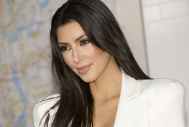 Kim Kardashian Denies Breast Augmentation, Kourtney Admits It